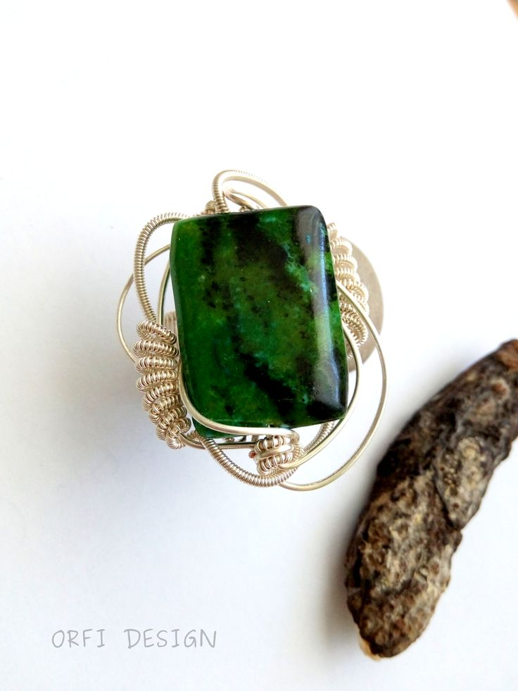 ...wire wrapped ring, with chrysocolla stone...handmade jewelry; wire wrapped jewelry...