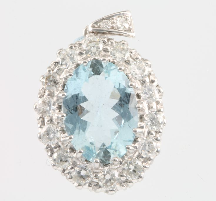 Lot 705, An 18ct white gold aquamarine and diamond pendant, the centre stone approx 5ct, surrounded by 14 brilliant cut diamonds approx. 1.5ct, on a diamond set loop, sold for £1,300