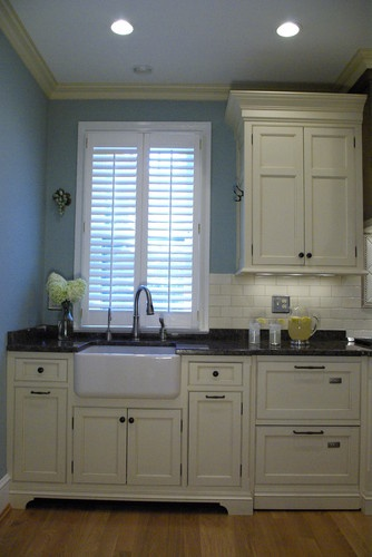 A combination of warm mahogany, rich glazed cream cabinets and a calming blue create an oasis in this old Washington home. We maximized storage while keeping an open feel in this galley kitchen. The hutch paint was custom matched based on a swatch of fabric with threads of blue, cream, and chocolate brown. Washington Treasure - eclectic - kitchen - dc metro - Bradford Design LLC
