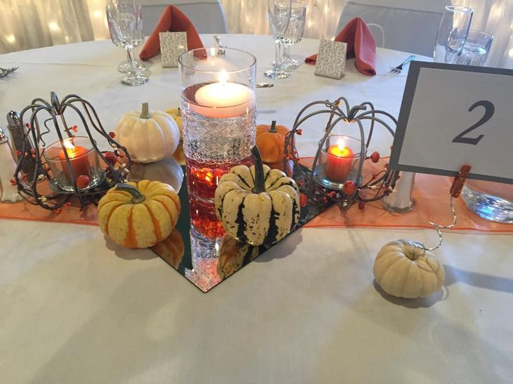 Wire pumpkins with candles cylinder vase orange