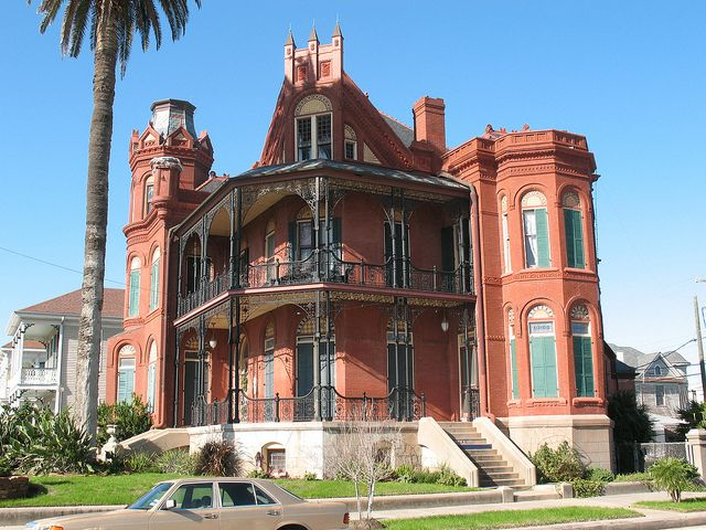 The Landes-McDonough House, Galveston TX, 1887-88.  Quite majestic but with an odd front - can't quite tell where the main entrance is.  Love the brick, the two asymmetrical towers, and the double porches with ironwork.