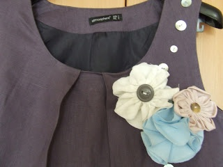 Upcycled old dressed- fabric flowers and buttons