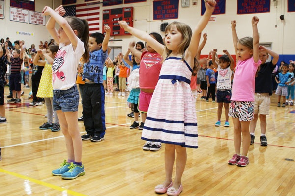 Alexandra Schmidt, Ryleigh Ortiz and Nera Weinstein nail the choreography during the 22nd Annual Kindergarten Festival on May 17. The families of Goshen's youngest students filled the bleachers in the Goshen High School gymnasium to watch the festivities, which combine physical education with music education.