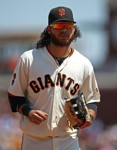 Giants-Dodgers tickets plunge to $6 after brutal start  -  April 24, 2017 SAN FRANCISCO, CA - JULY 27: Brandon Crawford #35 of the San Francisco Giants runs off the field against the Cincinnati Reds during the game at AT&T Park on Wednesday, July 27, 2016 in San Francisco, California. (Photo by Brad Mangin/MLB Photos via Getty Images)