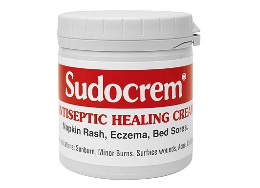 Sudocrem has been hailed as a cure for acne. Personal experience: it helps with spots, but its true magnificence is in dealing with that hideous little fraying dry skin that always hangs about a dying spot!