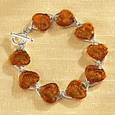 Baltic Amber Heart Bracelet | A handful of amber beads are linked with sterling silver in this heartfelt bracelet. | National Geographic Store