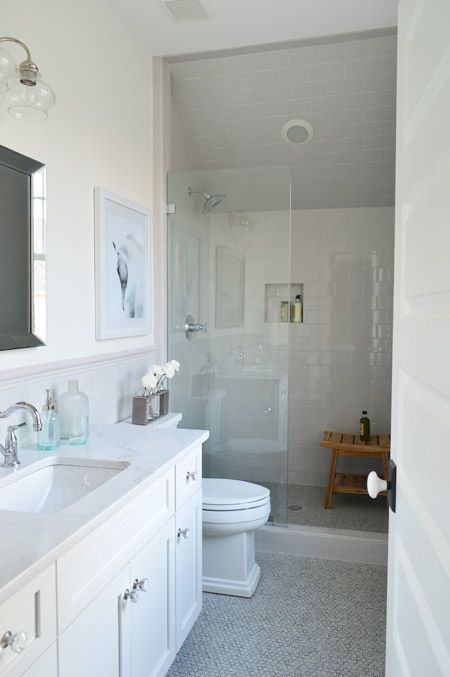 Showhouse guest bath with classic tile and a clear glass shower enclosure