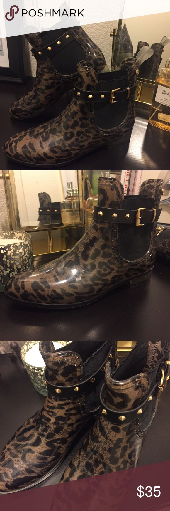 Gorgeous, AUTHENTIC Henry Ferrera Ankle Rain Boot Authentic!  Worn ONCE. Great condition. Rain-proof plastic exterior.  Leopard patterned. Gold metal detail. These are so, so cute! Size also fits 7.5 very well! henry ferrera Shoes Ankle Boots & Booties