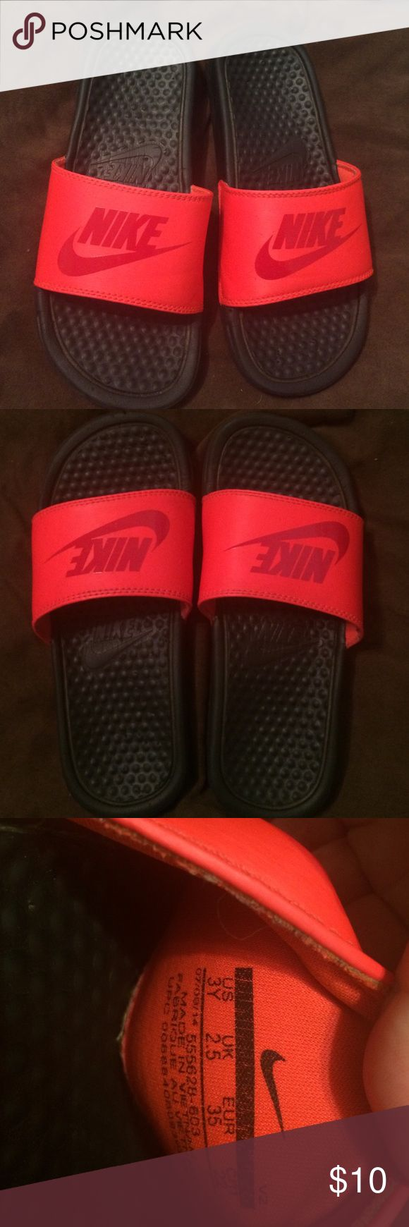 Nike sliders Y- size 3 red/fluorescent orange Size 3 youth Nike sliders- have been used & up close you can see some puppy marks - see last pic - but still in good condition! Nike Shoes Sandals & Flip Flops