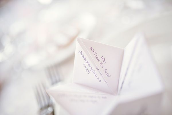 What a fun idea to entertain wedding guests! A wedding cootie catcher with bride and groom trivia for each reception table.