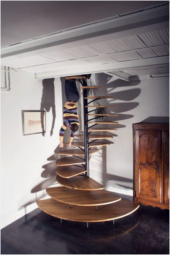 French designer Paul Coudamy, designed this unconventional spiraling oakstaircase in a private home is Paris, France.His concept, elegantly mixing functionality and aesthetics, connects the ground floor with the first floor in virtually any environment you can imagine such as houses, studios, stores or any other housing space available. The fan-shaped trades, wide at the bottom and narrow at the top, represent the very core of it. Comprising both, elegance and simplicity, this stunning sta