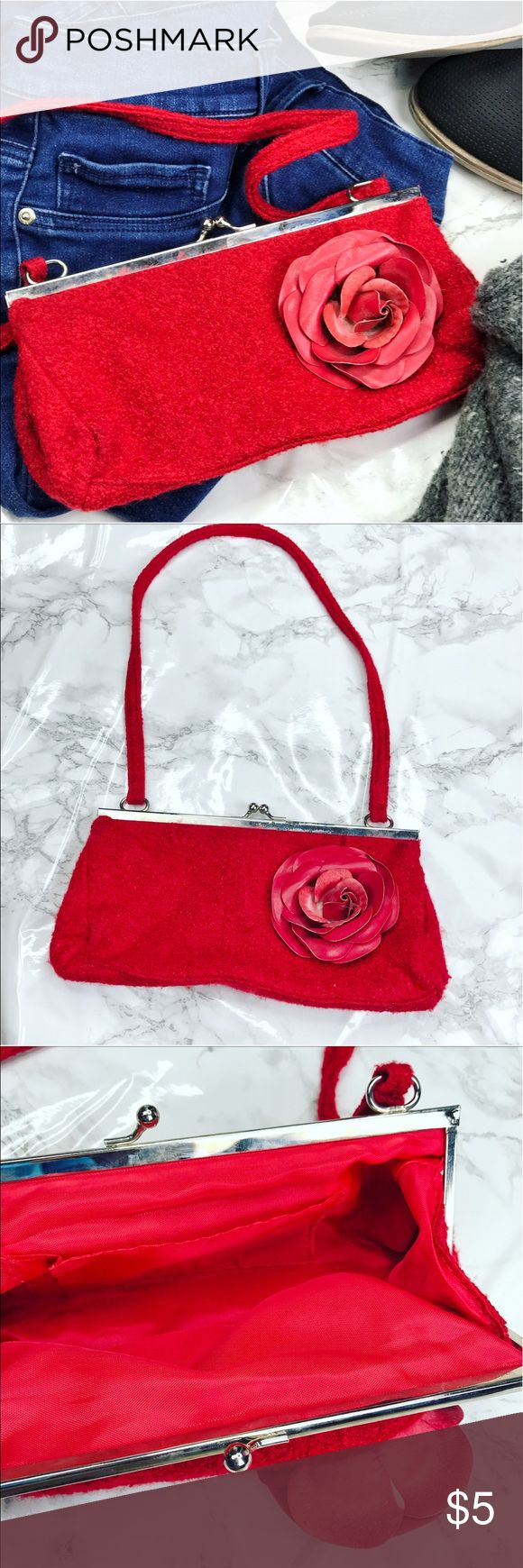 🌹Red Clutch Bag 🌹 Red Clutch/ Handbag With a red rose. One pocket inside. Shell: 100% Polyester; Lining: 100% Nylon. *Price Firm Unless Bundled* Bags Clutches & Wristlets