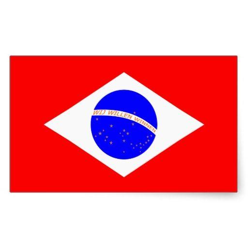 """Stickers met Braziliaanse vlag in rood-wit-blauw, gouden sterren en oranje tekst """"Wij willen winnen""""."""