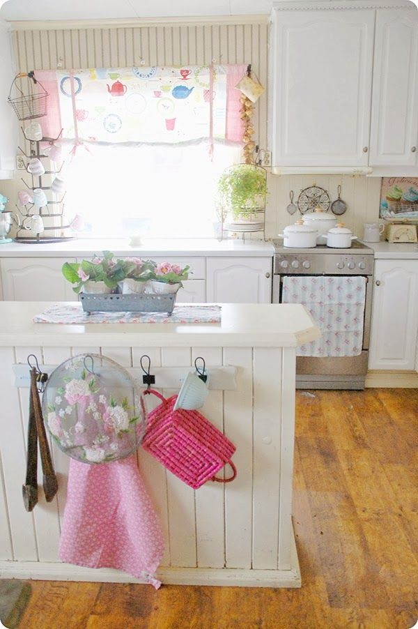 Kitchen island in pastel kitchen - looks like a happy place