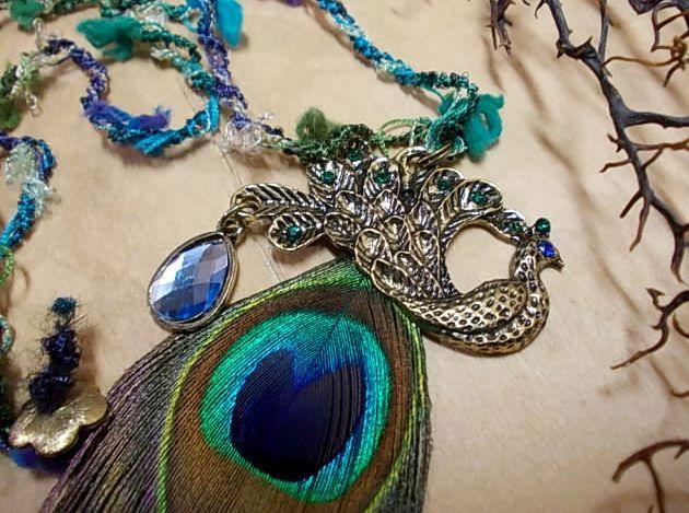 Pendant with antique bronze peacock in multicoloured cord...