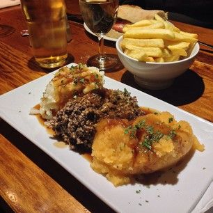 Haggis, neeps, and tatties at The Clachaig Inn, Glencoe, Argyll. | 25 Things Everyone Must Eat In Scotland