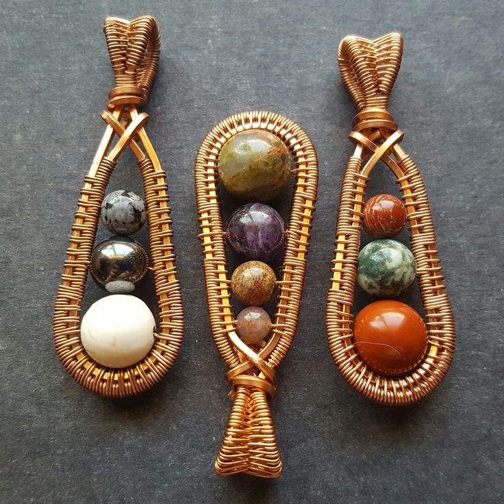 Handmade wire wrapped pendants featuring an array of natural stone beads. Made in raw copper. Orignal design by Michelle Shearer, of Wire Moon Jewelry. #throwbackthursday to these funky pendants. Maybe I should bring them back. What do you think?