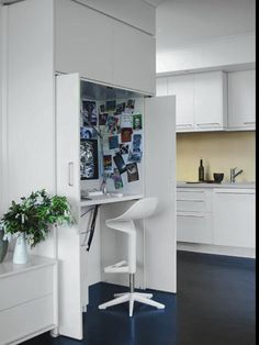 Sleek Hidden Home Office Incorporated Into The Kitchen