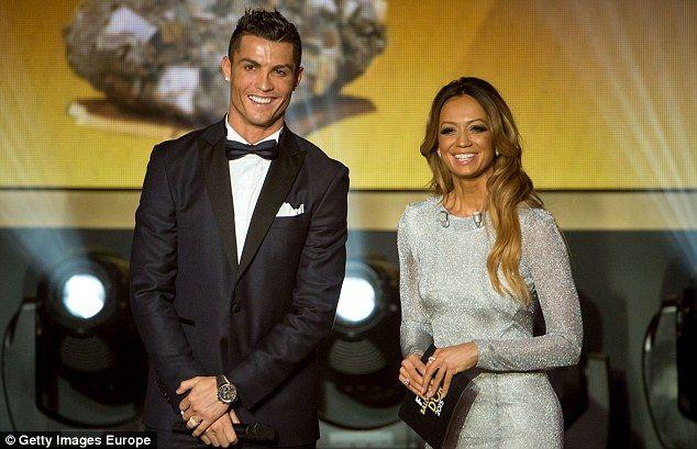 Ronaldo alongside presenter Kate Abdo is all smiles during the FIFA Ballon d'Or Gala for 2...