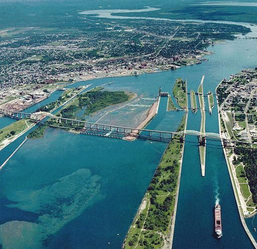 Aerial view of the Soo Locks between Lake Superior and Lake Huron, between the cities of Sault Ste. Marie, Michigan, USA (right) and Sault Ste. Marie, Ontario, Canada (left).