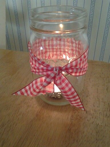 Tea light holder to go on tables at western themed party Material: Mason jar, tea light candle and ribbon.