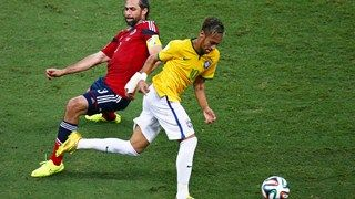Neymar of Brazil is challenged by Mario Yepes of Colombia Friday, 4 July 2014