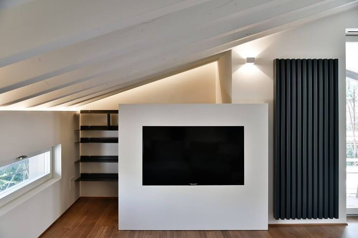 #Soho design Ludovica+Roberto Palomba.The external light intermingles with the architecture of this private apartment in San Zenone, Treviso, and plays with the sober lines of our radiator Soho.  Project by architect Claude Petarlin. www.claudepetarlin.com #Tubesradiatori #Project #ClaudePetarlin