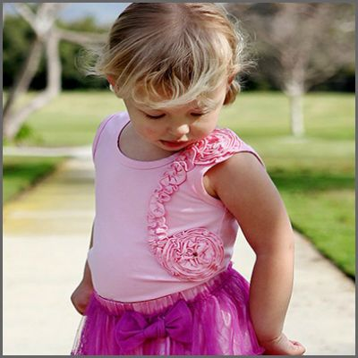 Swirl Ruffled Pink Tank. Sweethearts will swoon at first sight of this fun, ruffled tank. Whimsical ruffles swirl like a breeze around this comfy, yet fanciful top. This top is simple and sweet for a casual day in the sun, or perfectly precious for a special occasion.
