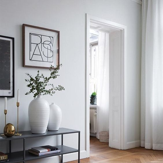 white decorative vases in modern Scandinavian interior