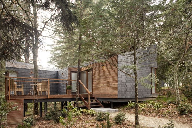 slate tile + wood slats - enables this home to seamlessly blend into its surroundings