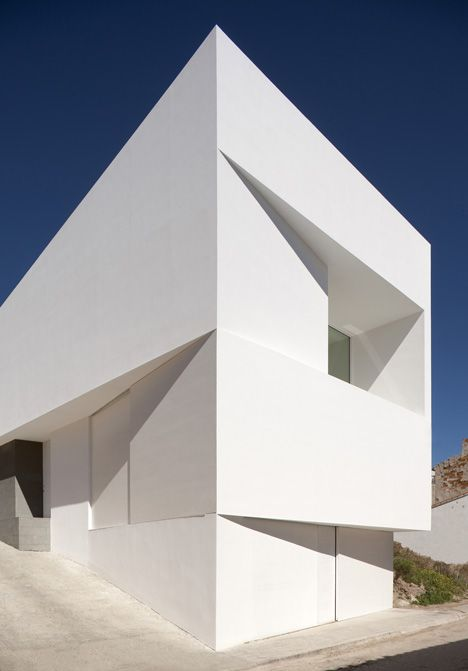 This bright white wedge-shaped house by Spanish studio Fran Silvestre Arquitectos thrusts out from the rock face behind it in the valley town of Ayora, near Valencia #Architecture