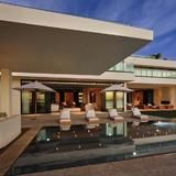 Set on 275 feet of water frontage in Miami Beach, Fla., baseball star Alex Rodriquez's contemporary mansion is bordered by a sleek vanishing-edge heated pool. Other outdoor amenities include covered terraces, an outdoor kitchen and a rooftop deck -- all overlooking the Biscayne Bay and the Miami skyline.