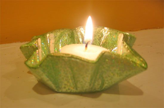 Upcycle: CD Votive Candle Holders ...tried this. It did not work.