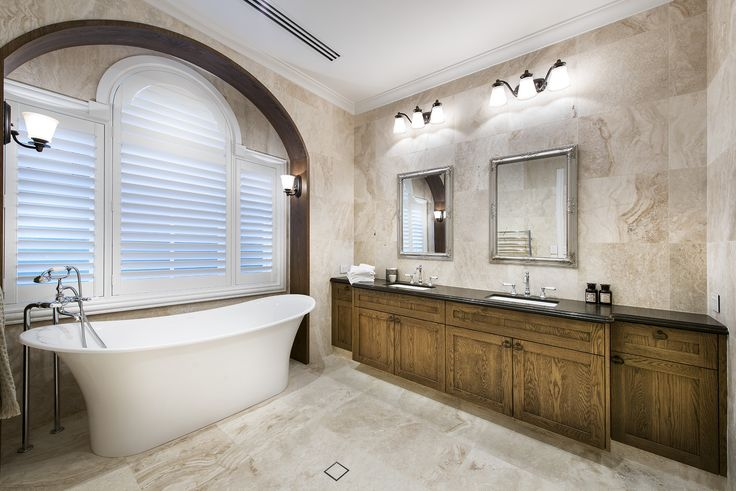 Hamptons style bathroom with stand alone bath tub - Oswald Homes