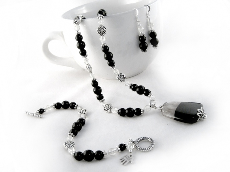 Jetta jewelry Set $46.00 Black Agate Geode, black Czech fire polished glass beads, clear crackled glass beads,  and Tibet silver are combined together for a stylish look. The necklace, and the bracelet are strung onto tigers tail wire for strength, durability and drape. Finished off with an ornamental toggle clasp. The earrings are strung onto silver plated wire.
