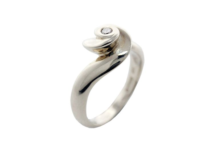 White gold rose ring.