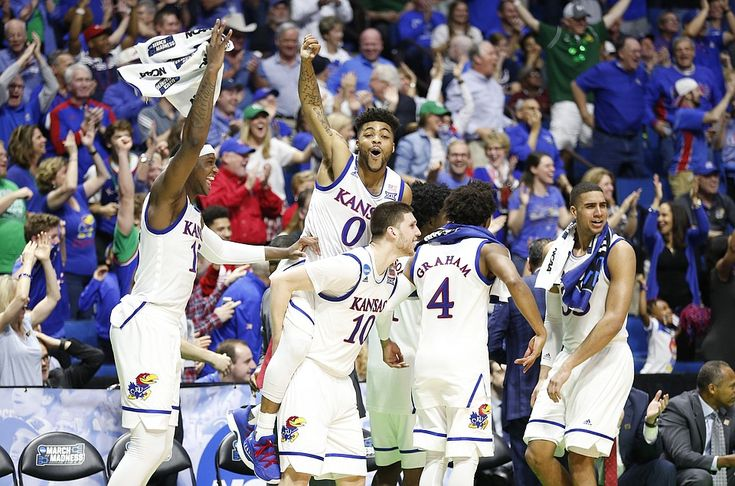 Kansas Jayhawk starters go wild on the bench, after (Coach Bill's son) Tyler Self scores a 3 pointer at the end of the NCAA first round game to finish the scoring at 100-62 over UC Davis, in Tulsa, OK.