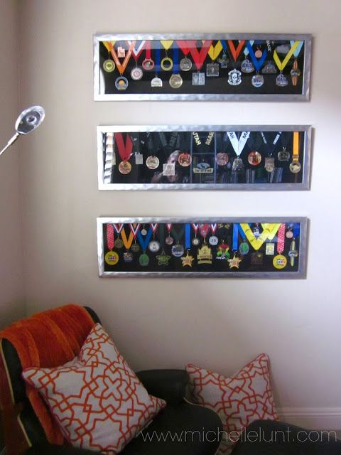 I love this method of displaying marathon medals.  It's neat and attractive at the same time. This could be used for kids' participation medals, 4H awards, etc. -- How to Display Marathon Medals: Honey I'm Home.