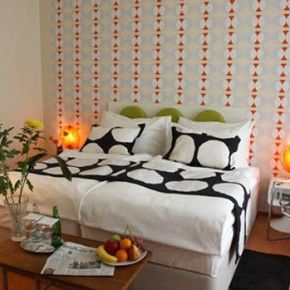 adult 70s bedroom with fun shaped wall patterns from getitcutcom - Retro Bedroom Design