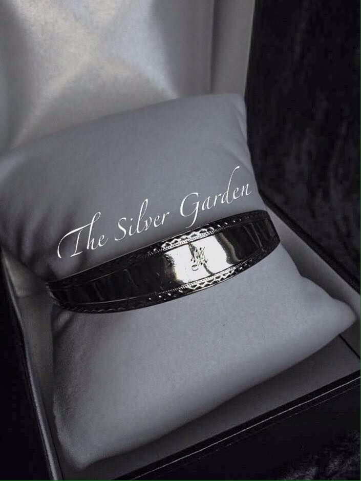 """SOLD!!!  www.facebook.com/TheSilverGardenJewellery * Pic 1 Silver M Bangle: This gorgeously simple & elegant silver sugar tong bangle was made by Fenton Bros Lts of Sheffield in 1910. It has a simple beading pattern engraved around both edges & a calligraphy M in the centre. This could be for Mum or an initial. Measures 8.5"""". £85 posted."""