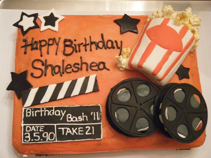 movie theme cake - Butter cream icing with gum-paste movie reels, popcorn box, and clapboard....popcorn is real.