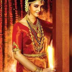 South Indian bride. Temple jewelry. Jhumkis.Yellow silk kanchipuram sari.Braid with fresh jasmine flowers. Tamil bride. Telugu bride. Kannada bride. Hindu bride. Malayalee bride.Kerala bride.South Indian wedding.Aishwarya Rai.