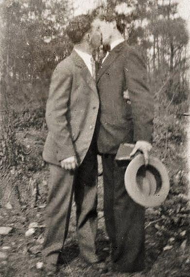 """""""Confirmed bachelors"""" sharing a kiss, United States, 1920-29, photographer unknown."""