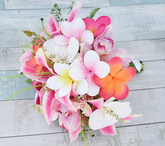 This is a beautiful -almost fresh- Hot Pink, Coral/Orange, Pink and Off White Mix of Stargazers, Orchids, Calla Lilies and Plumerias Natural Touch