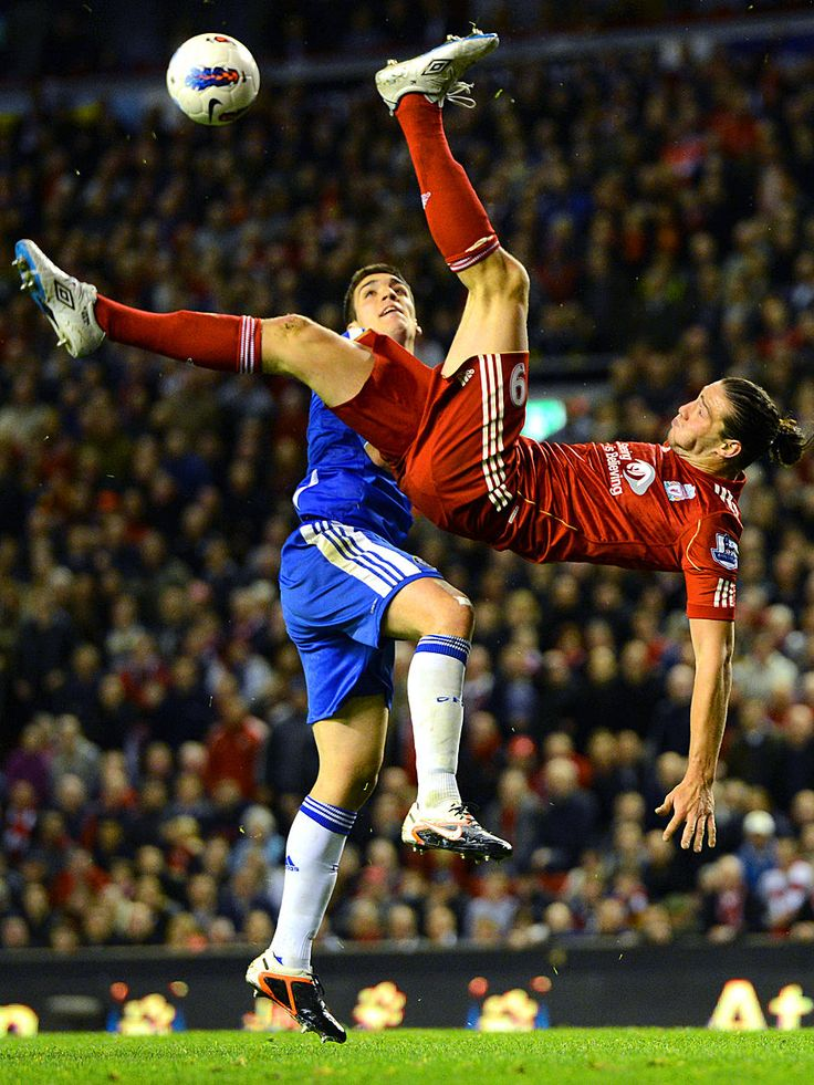 Flip Side - Liverpool's Andy Carroll attempts an overhead kick during his team's 4-1 win over Chelsea in their English Premier League soccer match at Anfield Stadium in Liverpool, England.