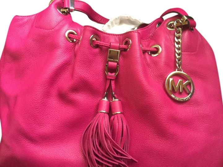Michael Kors Fuschia Shoulder Bag. Get one of the hottest styles of the season! The Michael Kors Fuschia Shoulder Bag is a top 10 member favorite on Tradesy. Save on yours before they're sold out!