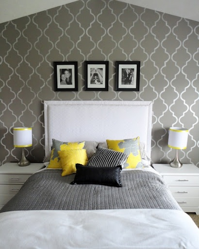Love the three picture frames above the headboard...maybe I can do navy instead of black??