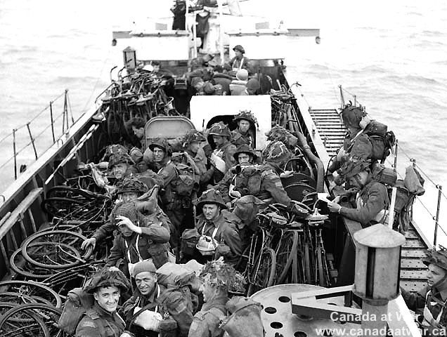 D-Day, Juno Beach - Personnel of the Highland Light Infantry of Canada and the North Nova Scotia Highlanders aboard LCI(L) en route to France.