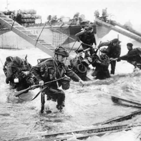 Commandos from the 48th Royal British Marines storm Juno Beach on D-Day