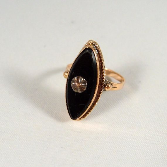 This is an elegant beveled plaque shaped black onyx ring.  It is enhanced with a…